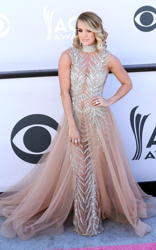 How tall is Carrie Underwood? Discover more Celebrity news, Heights, Carrie Underwood's Net Worth 2021, Age, Husband, Songs, and Boyfriend.